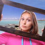 Woman Holding Frame, travel concept