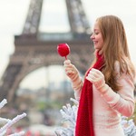 Girl with caramel apple in Paris